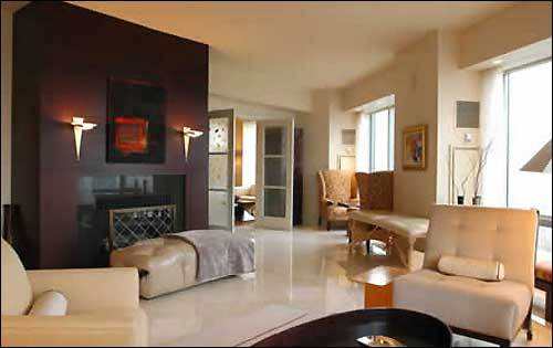 On the other side of the living room is one of the two working fireplaces in the unit. The 4,421-square-foot condo on the 37th floor of the North Tower has four bedrooms, six baths, and a large balcony. It is for sale for $8.4 million.