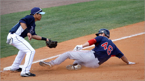 Outfielder Jacoby Ellsbury slides safely into third base ahead of Roy Olmedo's tag during a March 7 game against the Rays. The Sox fell to Tampa Bay, 15-7, in Port Charlotte.
