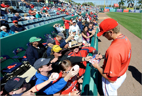 Lars Anderson signed autographs before a game against the Cincinnati Reds on March 3. The Reds beat the Sox, 9-8, after Cincinnati's Jonny Gomes hit a grand slam.