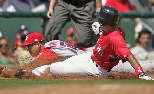 Julio Lugo (right) slides out at third as Puerto Rico's Ramon Vazquez makes the play, ending the second inning of the March 5 game. Puerto Rico beat the Sox, 9-5.