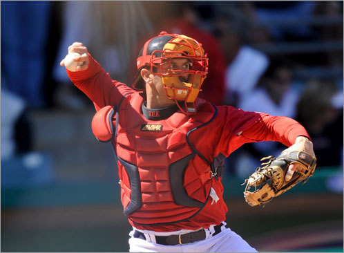 Catcher Jason Varitek throws to second base during the March 3 game against the Reds in Fort Myers.