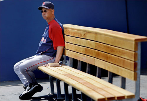 Where are the Sox? Manager Terry Francona sits alone on the bench before a spring training game against the Tampa Bay Rays in Port Charlotte, Fla., on March 7.