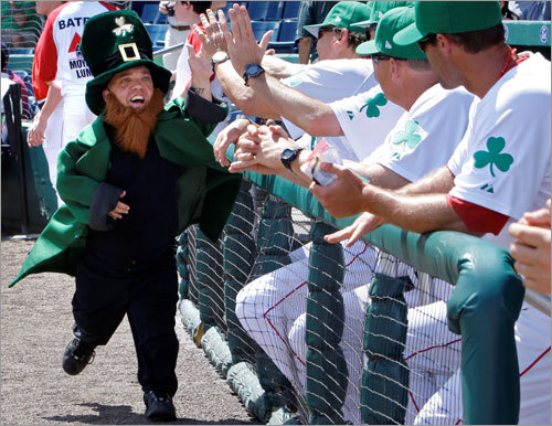 Tedi Valentine, in leprechaun regalia, high-fived Sox players prior to their game.