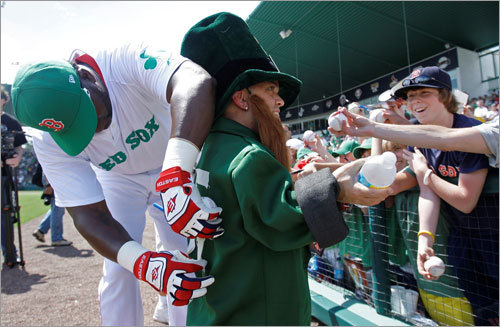 Dressed as a leprechaun, Tedi Valentine of Cape Coral, Fla. talked to fans as Red Sox designated hitter David Ortiz taped No. 15, Dustin Pedroia's number, on his back. The Red Sox wore green uniforms Tuesday in honor of St. Patrick's Day.