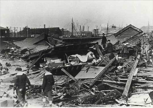 Sailors search through rubble in Boston's North End following the Great Molasses Flood in 1919, in an image from the book 'Dark Tide' by Stephen Puleo.