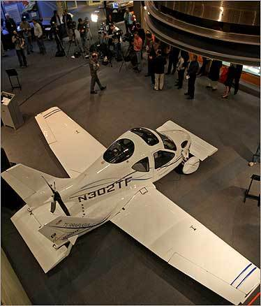 The Transition, left, is a two-seat aircraft designed to take off at local airports and drive on any road. It is made by a Woburn-based company, Terrafugia, which was founded by five pilots who graduated from MIT.