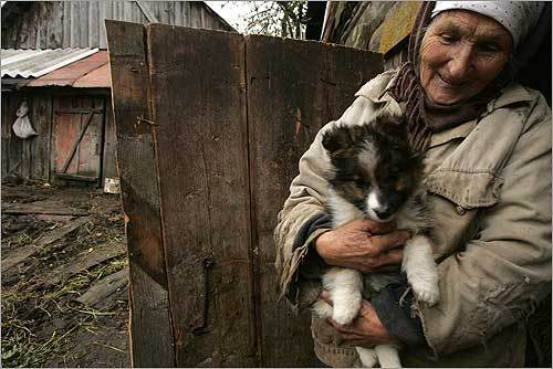 Olga Yvanova, who lives in the village of Zahary in Belarus, proudly displayed her puppy. She keeps the dog in her hay barn with several cats.