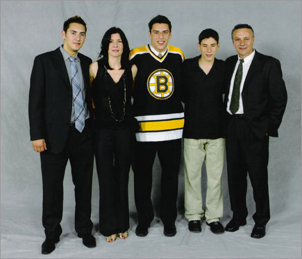 Lucic's mother, Snezana (second from left), arrived in East Vancouver when she was 2. His father, Dobro (far right), grew up in Sarajevo, where World War I was kindled, and emigrated at 29, becoming a longshoreman because there was no market for his background in Yugoslav law. Three sons arrived within four years - Jovanin 1987, Milan (center) in 1988, and Nikolain 1990.