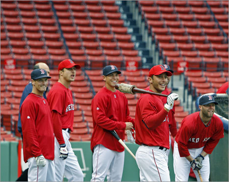 The Sox squeezed in some batting practice before the rain began. Players (left to right) Nick Green, Rocco Baldelli, Jacoby Ellsbury, George Kottaras, and Dustin Pedroia watch the flight of a long ball that teammate David Ortiz (not pictured) has just hit to deep right field.