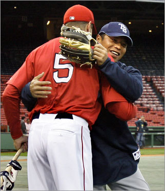 Akinori Iwamura (right) of the Tampa Bay Rays hugs former teammate Rocco Baldelli at Fenway on Monday morning. Baldelli signed with the Sox during the offseason after spending last season with the Rays.
