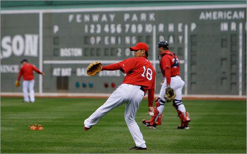 Sox pitcher Daisuke Matsuzaka throws during practice on Monday afternoon.