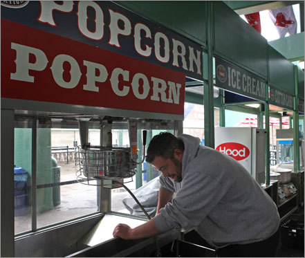 With another day to prepare for the start of the season, Sean Kimsey cleans up his popcorn stand at Fenway.
