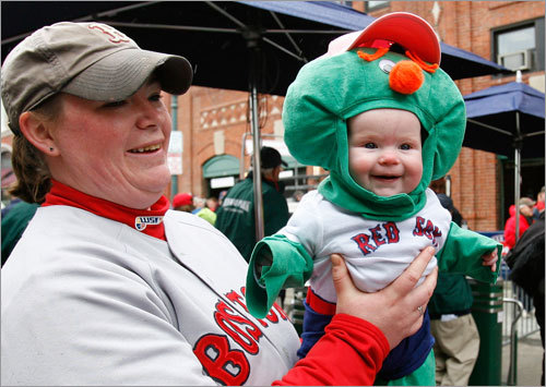 A child dressed as Red Sox mascot Wally the Green Monster got in the spirit of Opening Day while staying warm.