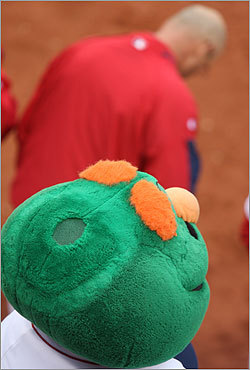 Even this Wally the Green Monster puppet removed its hat for the Boston Pops' rendition of 'God Bless America' during the seventh inning stretch.