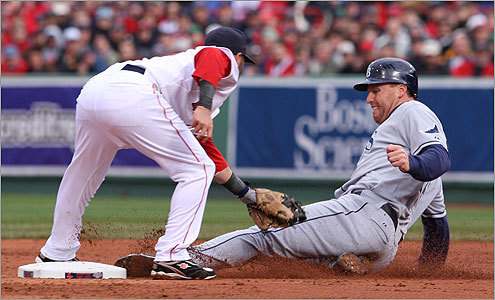 Tampa Bay's Gabe Gross slid into second base safely in the third inning. The Rays scored a run in the inning to tie the score 1-1.
