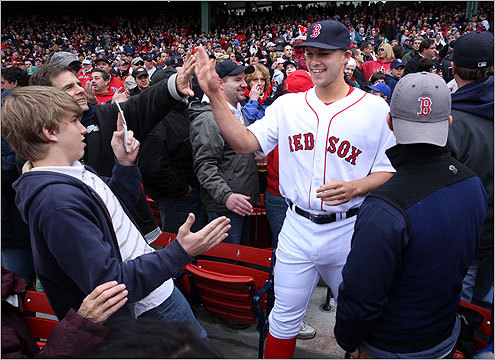 Pitcher Justin Masterson greeted fans as he walked through the stands en route to the field during player introductions.