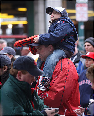 Christian Silva of Dartmouth got a lift on his father Jason's shoulders as they headed into the park.