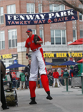Yawkey Way mainstay 'Big League Brian' walked the concourse in stilts before the season opener.