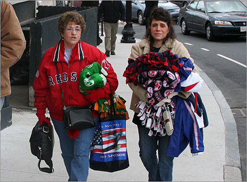 Beverly Bartolomei (left) of Bolton and her daughter Cheryl Pileeki had the good sense to bring blankets in anticipation of colder temperatures as the game progressed. Temps were in the mid-40s for much of the afternoon.