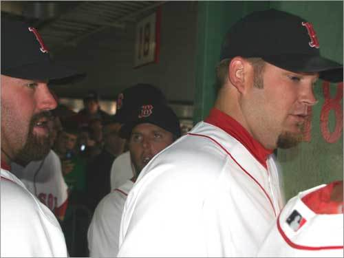 Kevin Youkilis and Brad Penny wait to be introduced to the crowd from the grandstand during the pregame ceremony.