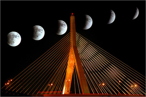 In 2003, a lunar eclipse made an appearance over Boston, and Globe photographer John Tlumacki chronicled the moon's rise and fall with a multiple-exposure shot framed by the lighted Zakim bridge.