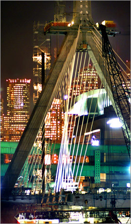 Even before it was built, the bridge made a dramatic presence with the backdrop of Boston's financial district.
