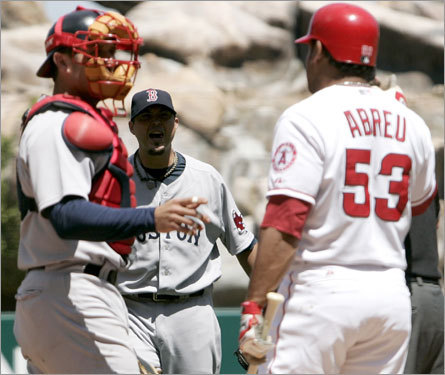 Josh Beckett (center) and Bobby Abrea ignited a bench-clearing scuffle in the first inning Sunday. The excitement began when Abreu called time and backed out of the box. Beckett, already in his wind-up, fired the ball at Abreu's head. Abreua barked at Beckett. Beckett barked back.