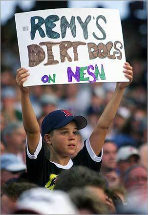 As he got more comfortable in the booth, however, Remy's popularity exploded among Red Sox Nation members young and old. Here, a boy tries to get the announcer's attention during a 2001 game.