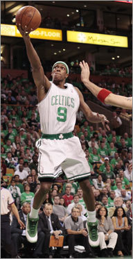 Boston's Rajon Rondo drives to the hoop during the first quarter.