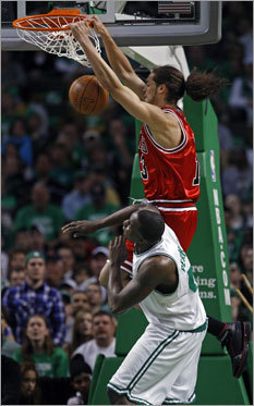 Chicago's Joakim Noah slammed home two points over Boston's Kendrick Perkins for the first score of the game.