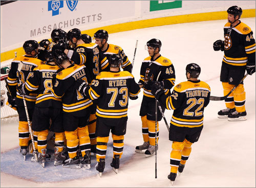 The Bruins gathered around Tim Thomas after their resounding 5-1 victory over the Canadiens in Game 2.