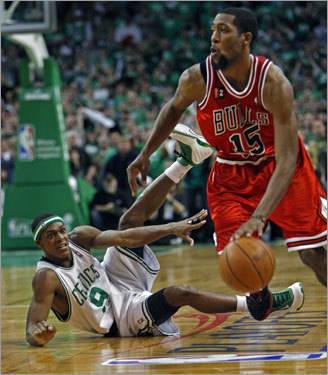 Rajon Rondo, who led the Celtics with 29 points and had just one turnover, lost this loose ball battle with the Bulls&#146; John Salmons with 15 seconds left in regulation.