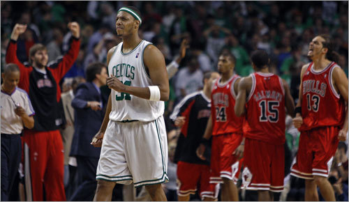 Pierce (23 points) wore a pained expression as time expired. The Bulls celebrated an unlikely win in the background.