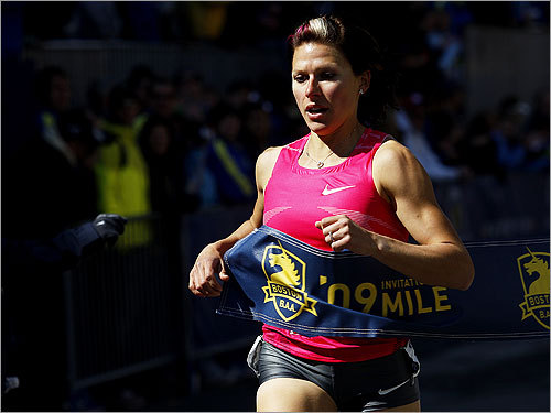First place winner, Anna Willard of the USA, crossed the finish line during the Elite Women's Invitational Mile with an official time of 4:38.6.