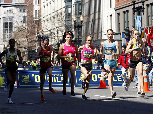 The women took off during the Elite Women's Invitational Mile during the Boston Athletic Association's 5K and Invitational Mile races.