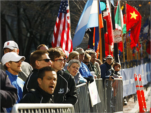 Spectators watched the 5K during the Boston Athletic Association's 5K and Invitational Mile races.
