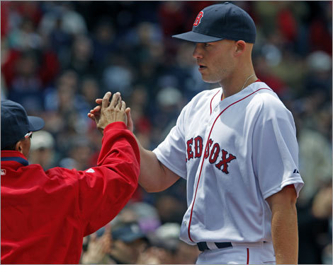 Masterson got a hand from Julio Lugo, who will join the PawSox on a rehab assignment soon, as he returned to the dugout after being taken out of the game in the sixth inning.