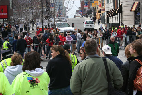 The crowd swelled in Kenmore Square as onlookers waited for the elite finishers.
