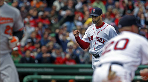 Red Sox reliever Manny Delcarmen pumped his fist after getting Ty Wigginton to ground into a double play to end the top of the sixth inning.