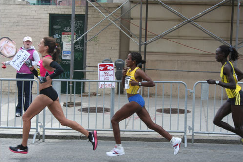 The leading three elite women runners took big strides as they entered the final mile of the race.