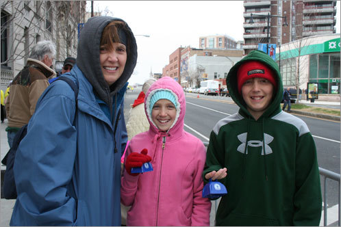 Elizabeth Clemens of Madison, Ala. and her two children, Rebekah, 10, and Matthew, 12, waited for their husband and father, Jim Clemens, to finish his third Boston Marathon. 'I hope he does better than his number: 1488,' Matthew said about his dad's place in the race.