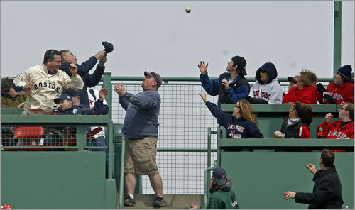 Fans in the Monster seats vied for Varitek's home run ball. The ball bounced to the fan waiting for it on the right, but he couldn't make the play.