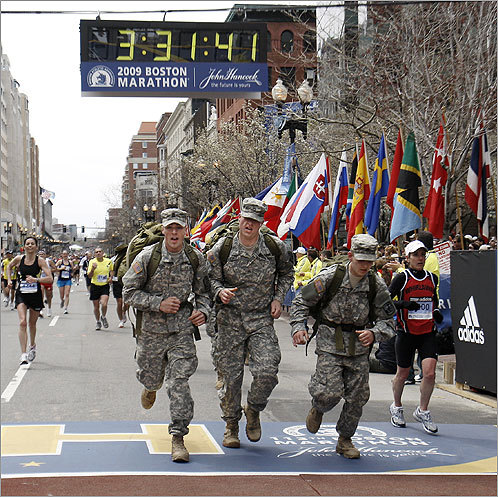 With full packs and in boots, members of the US Army crossed the finish line.