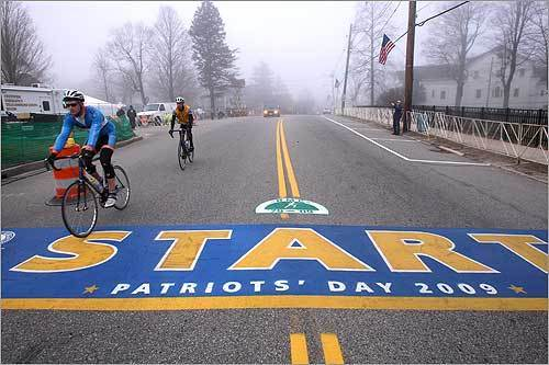 Bikers rode over the marathon's starting line in Hopkinton at about 6:30 a.m.
