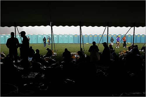 Marathoners gathered under a tent in the Athlete's Village in Hopkinton.