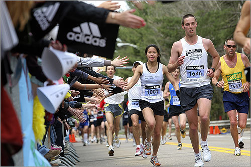 Spectators in Wellesley reached out to slap runners' hands.