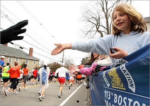 Ten-year-old Elizabeth Kistner of Hopkinton offered her hand to runners, as she has for the last six years in her hometown.
