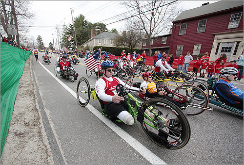 Participants in the wheelchair division raced down the course in Hopkintown.
