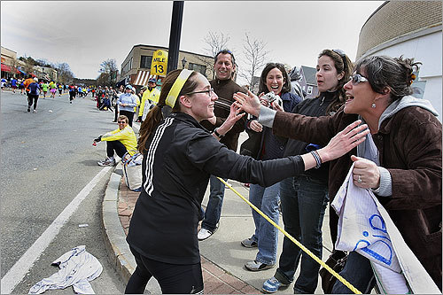 Runner Jessica Rosenthal of Newton was greeted by family members on the sidelines in Wellesley.