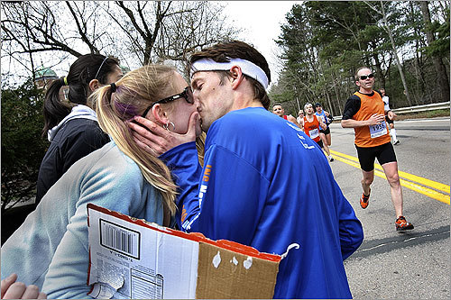 Wellesley student Lauren Dow solicited and received kisses from runners.